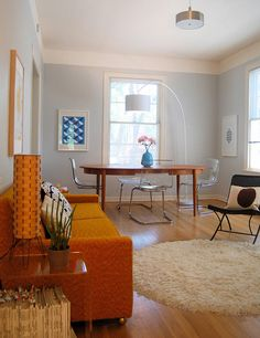 loving this orange vintage couch and just about everything in this room