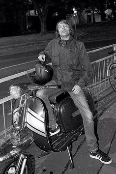 Ace bass guitarist Mani from the Stone Roses shows off his scooter and 3-stripes