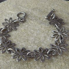 Stainless Steel Daisy Bracelet by WireNWhimsy on Etsy, $24.00
