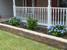 We finished our project. Vinyl/plastic railings that never need painting and a new retaining wall garden. I love my front porch!