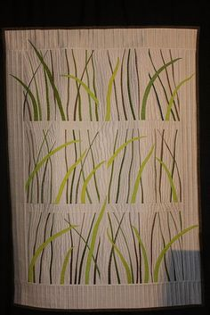 From 2011 Long Beach International Quilt Festival.  Love the way a few of the stems break out of their rows.