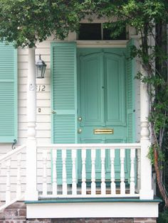 teal blue front door and shutters