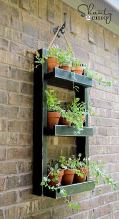 """""""Cute Hanging Wall Herb Garden"""" - I'd paint the front of the shelves with chalkboard paint so I can write what herbs are in the containers."""