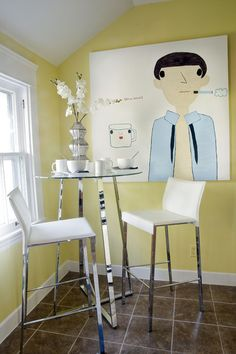 Small can be sleek. Embrace the fresh color palette and lively atmosphere of your favorite café with a tall table and slender chairs. Keep the mood light with a refreshing citrus hue on the walls and a piece of art that makes you smile. eclectic dining room by Eclectic Living Home
