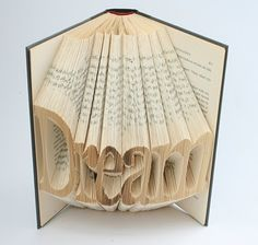 Book of Art is a husband and wife team, Issac and Veronica. Isaac is the master behind the art and Veronica, the manager. Their creations started in 2000, inspired by book art they saw.