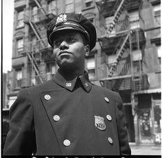 Officer in Blue, Harlem, 1943    African American police officer in Harlem, New York, circa 1943. Photographer Gordon Parks for the Office of War Information (OWI).