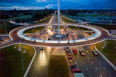 The Hovenring, in the Dutch city of Eindhoven, is a cable-stayed circular bridge for cyclists and pedestrians, and the first of its kind in the world. The 72-meters diameter bridge is suspended from a single 70-meter pylon located at the center of the roundabout by 24 cables, and appear to float over a large new junction for motorized traffic. With thin decks and conspicuous lighting, Hovenring is a new landmark for the city.