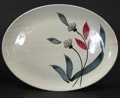 Mid Century Modern Stetson China 13 3/4 x 10 1/4 Oval Platter Backstamp reads Hand Painted Under Glaze Copyright 1955 Stetson China Co. Lincoln, ILL Floral decoration with gray and red leaves on a pink wash background. Good condition with no chips, cracks or stains. Some minor crazing. I will be listing several items in this pattern at this time. $24.99 2017