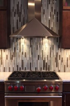Kitchen backsplash- love the the tile going vertical, instead of ordinary horizontal way