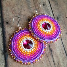 Vibrant round beaded earrings by BuffaloGirlCreative on Etsy. I love this shop!!