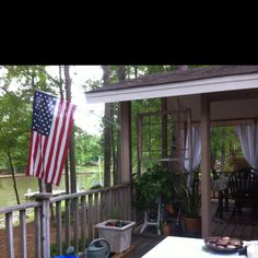 Hung an old window frame on porch, no glass, lots of WOW!