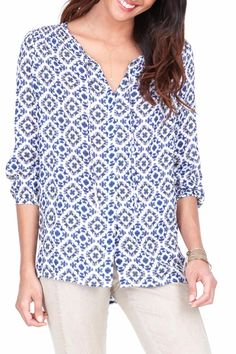 We imagined ourselves in the Greek Isles surrounded by clear blue sea and sand white stucco buildings when we designed this print. Pair it back to our garment dye tencel stretch pants and shorts for an easy summer look. 100% Viscose Hand wash cool lay flat to dry.  Cinched-Back Print Top by Ecru. Clothing - Tops - Blouses & Shirts Michigan