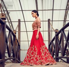 Captured in traditional silhouette, The bridal stands out due to its uniqueness and the perfect fusion of modern cut and traditional embroidery. This dress is beautifully decorated with heavy embroidery. It is highlighted with kora, dabka, tilla, sequins and pearls. Off shoulder blouse is enhanced with zardosi work all over. It comes with full embellished lehenga adorned with floral booties and vertical lines all over it. Zardosi Work, Heavy Dresses, Pakistani Bridal Wear, Red Fabric, Wedding Wear, Floral Blouse, Dream Dress, Dress For You, Lehenga