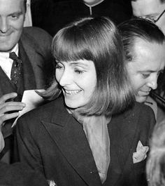 Greta L Gustafson aka Greta Garbo, surrounded by  the press as she returns to New York from Italy in 1938.