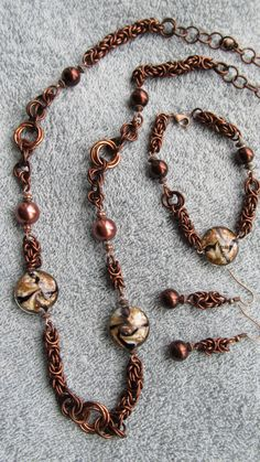 Beautiful dark copper-colored chain maille jewelry