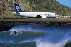 "Surfer in ""The Corner"" next to airport runway, Lyall Bay, Wellington, New Zealand Air New Zealand, Moving To New Zealand, New Zealand Landscape, Kiwiana, South Island, France, Auckland, Lonely Planet, What Is Like"