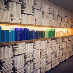 Nerwallet's reception lobby installation of books and 3D letters,  twenty feet long. A collaboration with Rapt Studio.