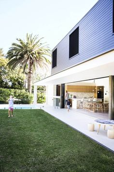 The dramatic box extension flows out into the newly landscaped rear garden. Childrens table and stools from [Mark Tuckey]( [object Object] Style At Home, Australian Homes, Indoor Outdoor Living, Outdoor Rooms, House Extensions, Facade House, Home Fashion, Exterior Design, Future House