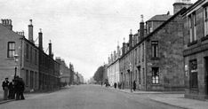 Old travel Blog photograph of shops, houses and people on Lennox Street in Renton in Central Scotland . Renton takes its name from Cecilia ...
