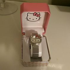 • Hello Kitty watch • This is a pre-owned EUC Hello Kitty watch, worn a few times. Super cute for all my fellow hello kitty lovers out there!! Has adjustable band, will need new battery when received. It comes with box which has tags. No trades, no paypal. Happy poshing! :) Hello Kitty Jewelry
