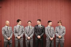 Groom in black w/ grey groomsmen. I like this, or maybe the other way around? I hate when the groom is dressed exactly like the groomsmen, it makes him look so unspecial!
