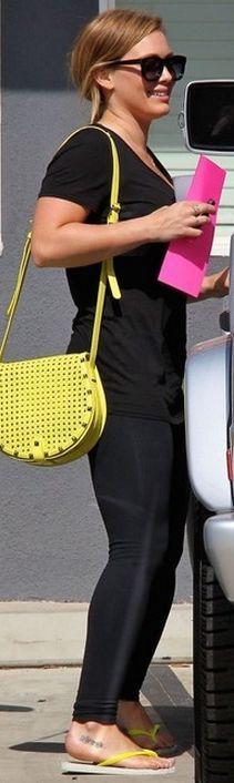 Who made  Hillary Duff's yellow handbag and black sunglasses?