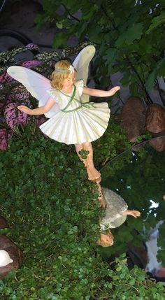 Miniature Fairy Garden - MIRROR, MIRROR IN MY HAND, WHO IS THE FAIREST IN THE LAND? is about a youthful fairy who sees herself in the reflection of the water. 8/2015