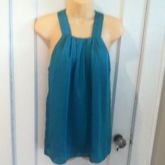 Tunic style blouse Tunic style blouse. Teal color top has two button closure in back. 100% polyester. Violet & Claire Tops Blouses