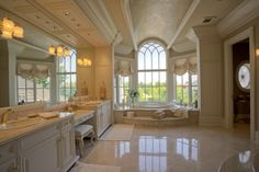 Traditional Master Bathroom with Arched window, Limestone, Flush, Crown molding, Durasupreme Cabinets - Venice Style Panel