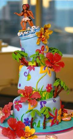 Whimsical tropical wedding cake featuring a surfer bride and groom.