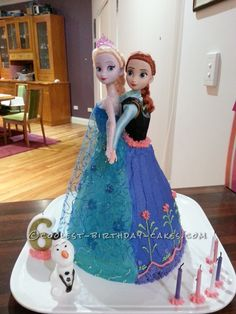 Coolest Frozen Anna and Elsa Cake... This website is the Pinterest of birthday cake ideas