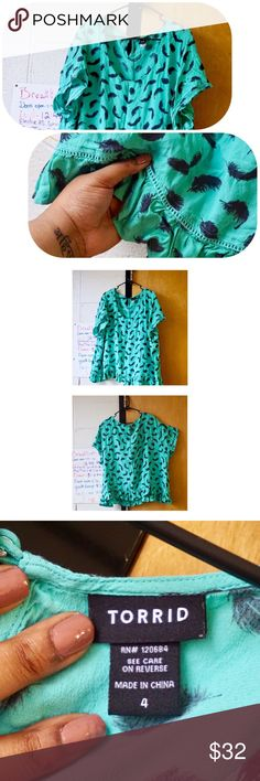 Feather Print Ruffle Blouse - TORRID Gorgeous mint-green and navy top that, in my opinion, is almost a crop top because it sits a little short, which is okay too! Pretty feather print and ruffled hem gives it a feminine touch. Never worn (too bright for me), size 4X. Make an offer, I promise I don't bite 💖 torrid Tops Blouses