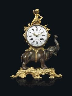 A LOUIS XV ORMOLU AND PATINATE