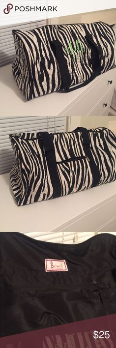 Travel duffel bag Travel duffel with interior and exterior pockets. Zebra print quilted fabric. Monogram MSH, but could easily be covered. Bags Travel Bags