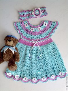 Baby knitted dress for the girl