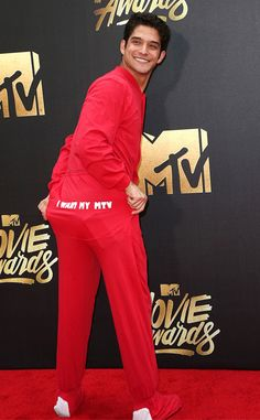 Tyler Posey from MTV Movie Awards 2016 Red Carpet Arrivals  Hooray for onesies! The Teen Wolf star opts for comfort over style in his foot pajamas.