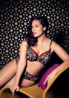 Elomi : Louisa, bandless bra and brief. A vibrant range featuring coloured lillies scattered onto a black base with tiny polka dots, trimmed with narrow embroidery stitched in red on contrasting black tulle.