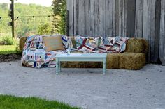 haybale sofa, quilts on hay, barn wedding ideas, farm wedding, haybale couch
