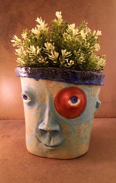 This one of a kind sculpture designed to be a stand out in your garden or in your home.  He is made of high fire clay and fired to 2200 degrees.  There is a hole in the top and  you can plant anything you like in him.  I think these pieces look great with succulents, cat grass or anything that grow