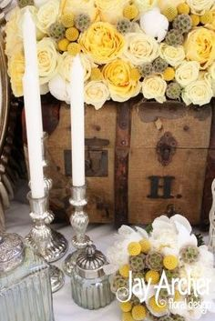 Table scape of vintage candlesticks and glassware, with rose and peony filled travel trunk and hadtied bouquet - by Jay Archer floral designs.