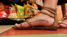 "Foot arch tattoo | A woman has a tattoo reading ""alis volat … 