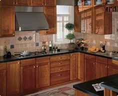 kitchen cabinet wood types | Wood Kitchen Cabinets Create Warmth | DirectBuy Kitchen Cabinets Blog