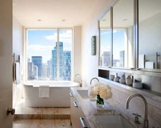 Oh what I wouldn't give to have a bathroom with a view like this!! I absolutely love it!!!!