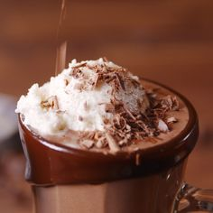 Homemade hot chocolate is super fudgy and wayyyy more delish than packaged mix. It's also insanely easy to make on the stovetop.  Top off each mug with a big scoop of vanilla ice cream and you're in for a dangerously decadent treat. Get the recipe at Delish.com. #delish #easy #recipe #cocoa #hot #chocolate #icecream #floats #winter #desserts