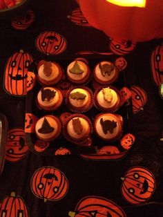 Our Halloween/Housewarming Party: Pumpkin cupcakes with cinnamon brown sugar buttercream topped with ghoulish fondant owls, bats, black cats and witch hats! I used the center shapes from my Wilton Halloween Linzer Cutter set. These are all made with chocolate fondant. The owls were brushed with bronze pearl dust, and the fondant for the bats, cats and hats was dyed black. I dusted the bats with white pearl dust, the cats with lilac purple pearl dust, and the hats with leaf green pearl dust!