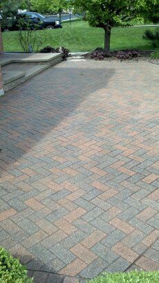 Brick Paver Patio after being repaired, cleaned and sealed by Paver Protector. | www.paverprotector.com #paverprotector