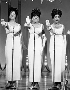"""The Supremes (l–r: Florence Ballard, Diana Ross, and Mary Wilson) perform """"Stop! In the Name of Love"""" in the early 1960s."""