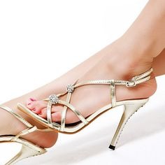 Strappy sandals with silver accents. | 17 Pairs Of Glamorous Golden Shoes