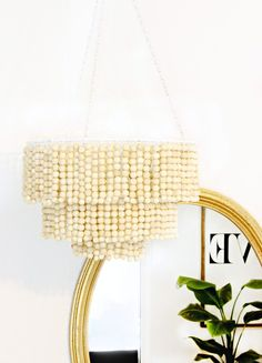 Lighting projects can instantly up the style and feel of a space. Oftentimes it gives the space the extra detail it needs to put it over the top! We were dying to make a wooden bead chandelier, and we