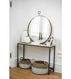 The pretty gold finish and detailing of this mirror adds a gorgeous accent to any wall. We especially love it in a bathroom or entryway. Shop the look with L&G! #LANDGATHOME